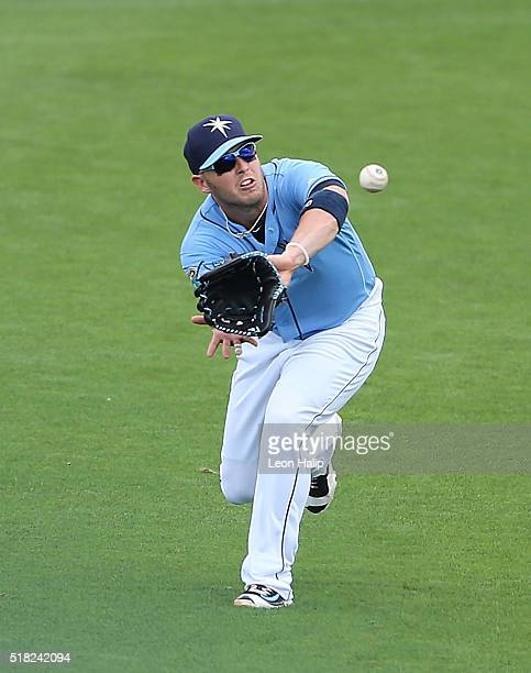 Corey Dickerson of the Tampa Bay Rays fields the line drive from Brock Holt of the Boston Red Sox during the sixth inning of the Spring Training Game...