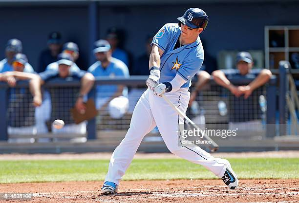 Corey Dickerson of the Tampa Bay Rays hits a single during the first inning of an MLB spring training game against the Toronto Blue Jays on March 9...