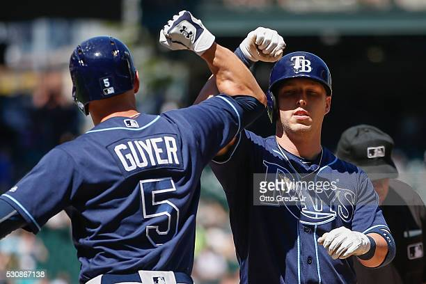 Corey Dickerson of the Tampa Bay Rays is congratulated by Brandon Guyer after hitting a grand slam against the Seattle Mariners in the sixth inning...