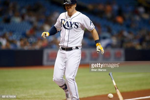 Corey Dickerson of the Tampa Bay Rays reacts after being hit with a pitch by pitcher Jason Hammel of the Kansas City Royals during the first inning...