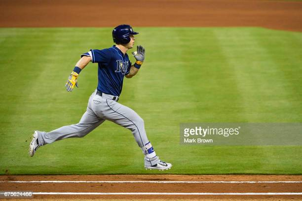 Corey Dickerson of the Tampa Bay Rays runs to first base in the third inning during the game between the Miami Marlins and the Tampa Bay Rays at...
