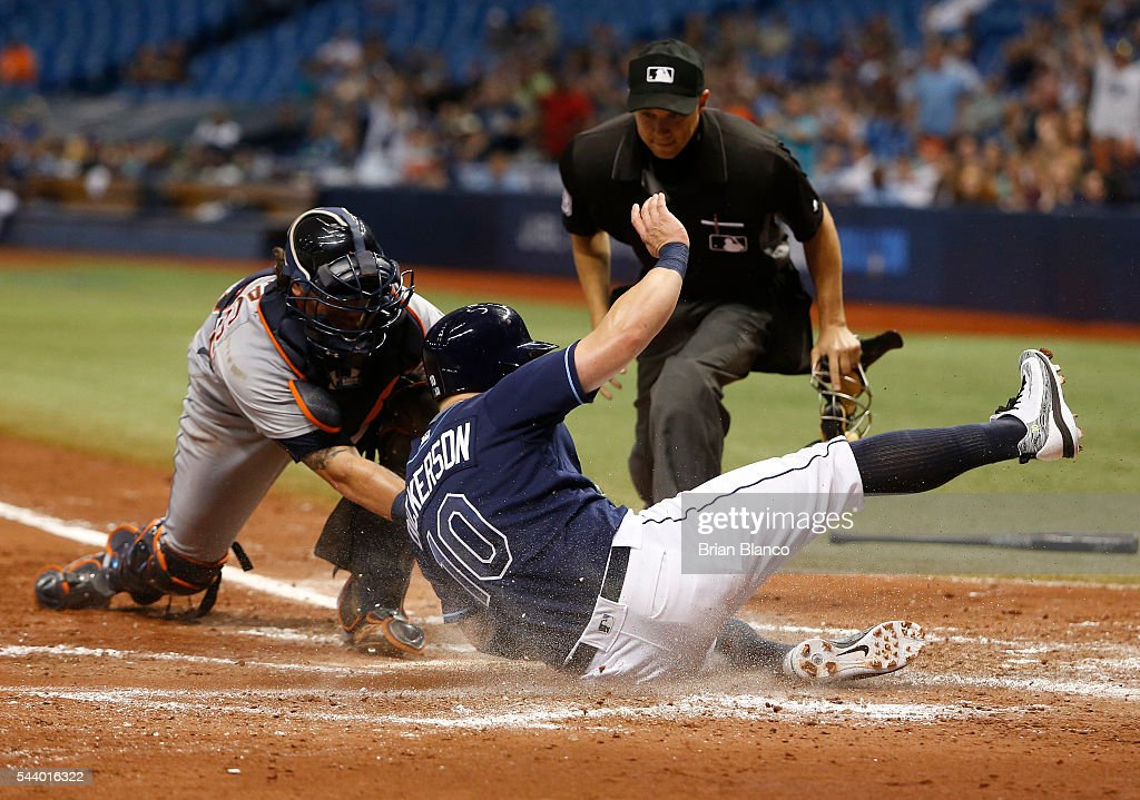 <a gi-track='captionPersonalityLinkClicked' href=/galleries/search?phrase=Corey+Dickerson+-+Baseball+Left+Fielder&family=editorial&specificpeople=15425201 ng-click='$event.stopPropagation()'>Corey Dickerson</a> #10 of the Tampa Bay Rays slides safely home ahead of catcher <a gi-track='captionPersonalityLinkClicked' href=/galleries/search?phrase=Jarrod+Saltalamacchia&family=editorial&specificpeople=836404 ng-click='$event.stopPropagation()'>Jarrod Saltalamacchia</a> #39 of the Detroit Tigers to score off of a three-run RBI double by Nick Franklin during the third inning of a game on June 30, 2016 at Tropicana Field in St. Petersburg, Florida.
