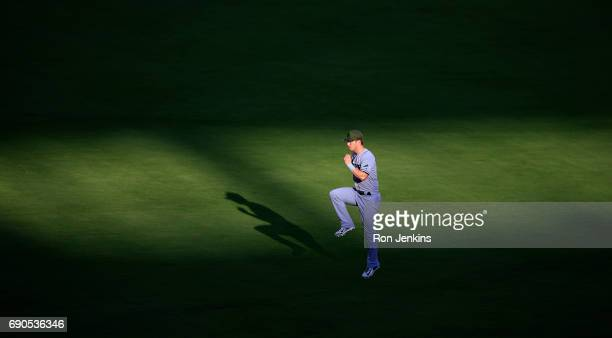 Corey Dickerson of the Tampa Bay Rays warms up before the game against the Texas Rangers at Globe Life Park in Arlington on May 29 2017 in Arlington...