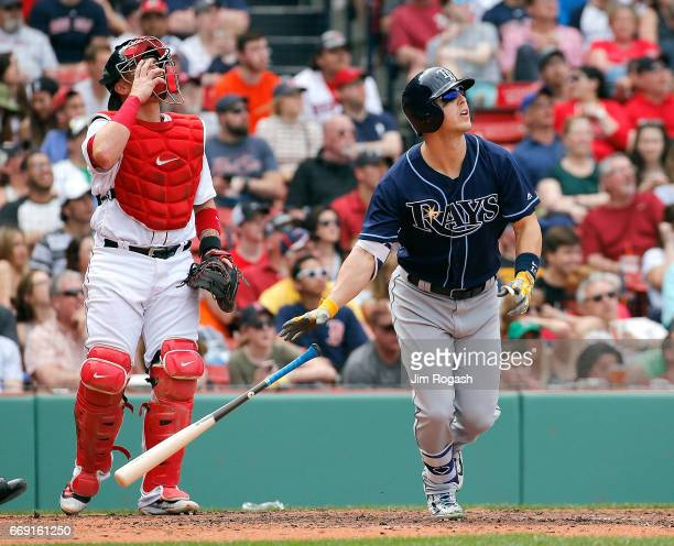 Corey Dickerson of the Tampa Bay Rays watches his home run in the fourth inning against the Boston Red Sox at Fenway Park on April 16 2017 in Boston...