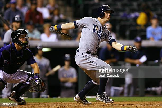 Corey Dickerson of the Tampa Bay Rays watches his RBI double during the ninth inning against the Colorado Rockies at Coors Field on July 19 2016 in...