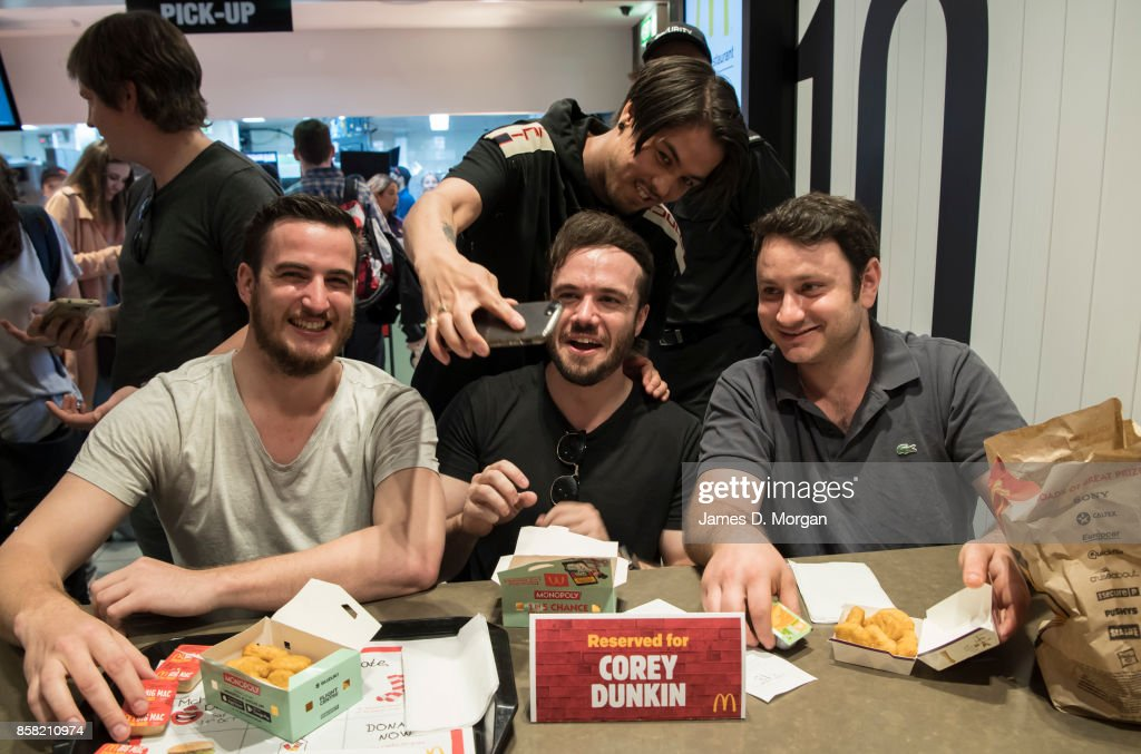 Corey Dunkin (c) enjoys some McNuggets at McDonald's George St on October 6, 2017 in Sydney, Australia. The McNugget fan's post on social media quickly went viral, with thousands registering their interest to attend. McDonald's responded by reserving a table for Corey to enjoy his chicken nuggets.