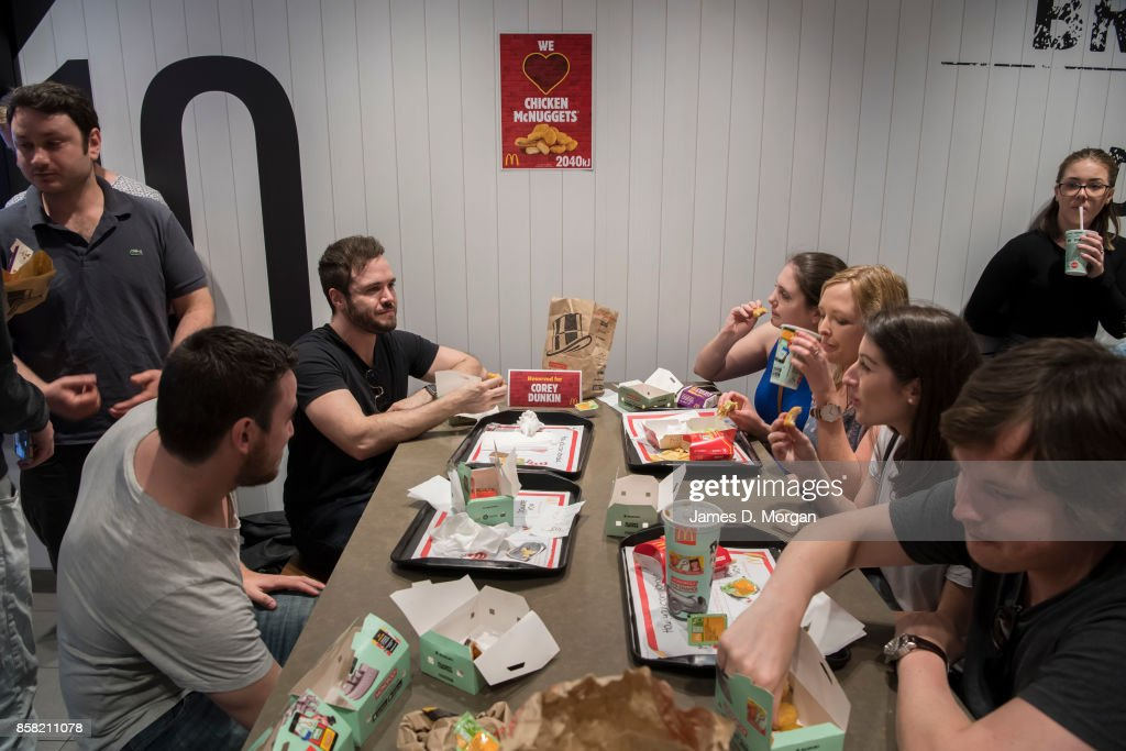 Corey Dunkin enjoys some McNuggets at McDonald's George St on October 6, 2017 in Sydney, Australia. The McNugget fan's post on social media quickly went viral, with thousands registering their interest to attend. McDonald's responded by reserving a table for Corey to enjoy his chicken nuggets.