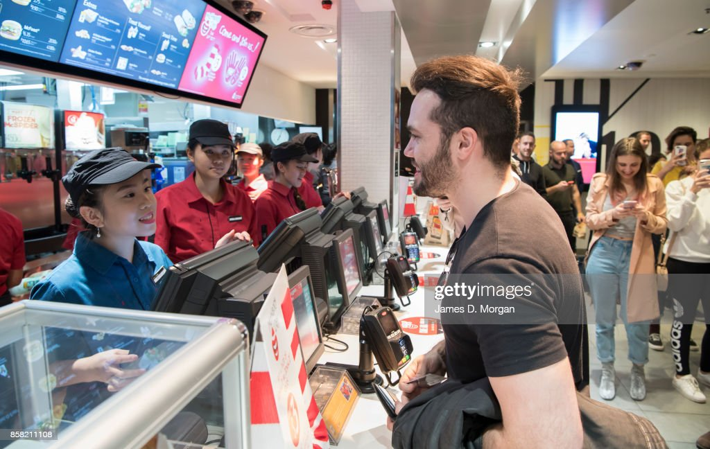 Corey Dunkin orders some McNuggets at McDonald's George St on October 6, 2017 in Sydney, Australia. The McNugget fan's post on social media quickly went viral, with thousands registering their interest to attend. McDonald's responded by reserving a table for Corey to enjoy his chicken nuggets.
