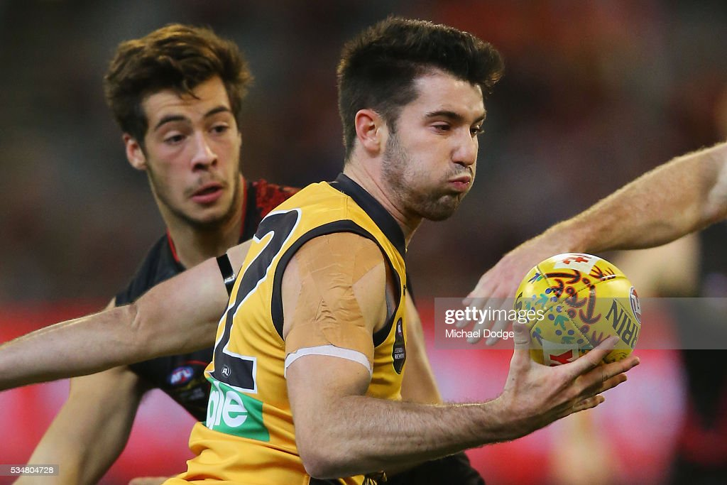 Corey Ellis of the Tigers gathers the ball during the round 10 AFL match between the Essendon Bombers and the Richmond Tigers at Melbourne Cricket Ground on May 28, 2016 in Melbourne, Australia.