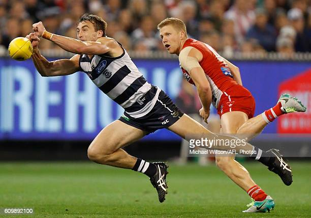 Corey Enright of the Cats and Dan Hannebery of the Swans compete for the ball during the 2016 AFL Second Preliminary Final match between the Geelong...