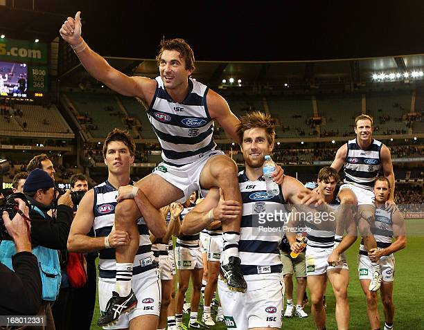 Corey Enright of the Cats is carried off the ground during the round six AFL match between the Richmond Tigers and the Geelong Cats at Melbourne...
