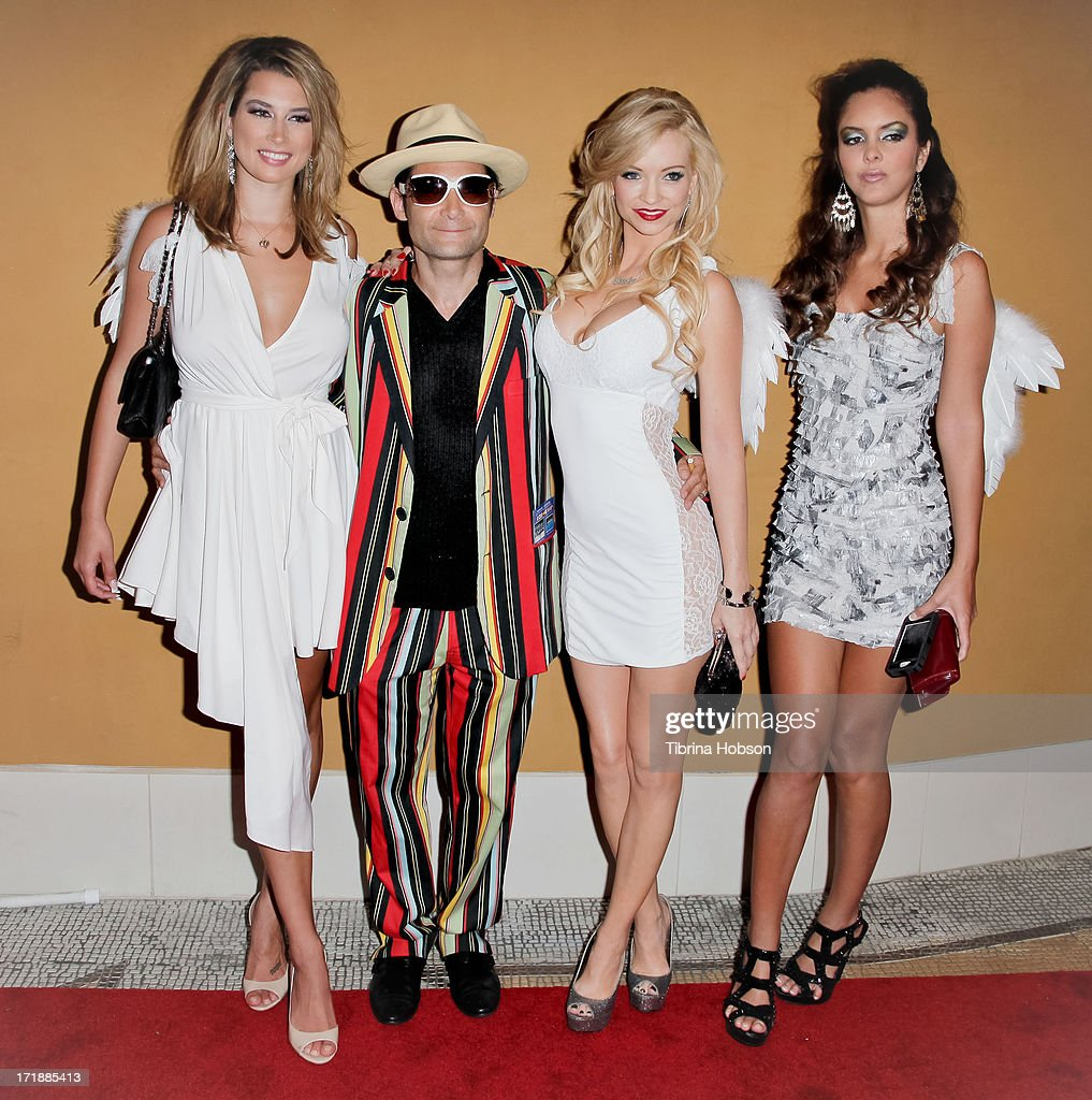 <a gi-track='captionPersonalityLinkClicked' href=/galleries/search?phrase=Corey+Feldman&family=editorial&specificpeople=175941 ng-click='$event.stopPropagation()'>Corey Feldman</a> (C) attends the launch of former Pussycat Doll Kaya Jones's Hollywood Doll Boutique at the Iconic Sweet! on June 28, 2013 in Hollywood, California.
