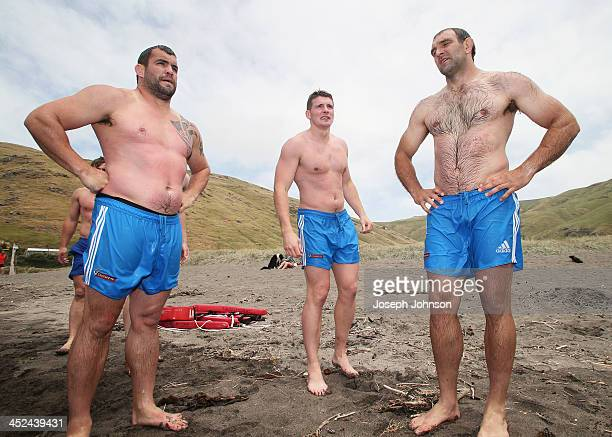 Corey Flynn Colin Slade and George Whitelock of the Crusaders during a surf lifesaving training day on November 29 2013 in Christchurch New Zealand
