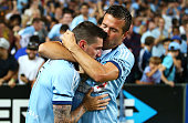 Corey Gameiro and Milos Dimitrijevic of Sydney celebrate a goal by Gameiro during the round one ALeague match between Sydney FC and Melbourne City at...