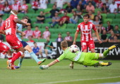 Corey Gameiro of Sydney FC beats goalkeeper Andrew Redmayne of the Heart to score the first goal during the round 17 ALeague match between Melbourne...