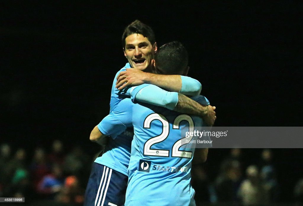 Corey Gameiro (L) of Sydney FC celebrates after scoring the first goal of the game during the FFA Cup match between Melbourne City and Sydney FC at Morshead Park Stadium on August 12, 2014 in Ballarat, Australia.