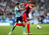 Corey Gameiro of Sydney FC competes with Jonathan McKain of United during the round 18 ALeague match between Sydney FC and Adelaide United at Allianz...