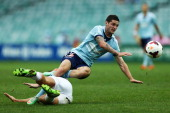 Corey Gameiro of Sydney FC is tackled by Rostyn Griffiths of the Glory during the round 19 ALeague match between Sydney FC and Perth Glory at Allianz...