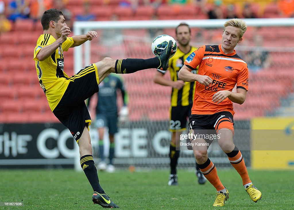 Corey Gameiro of the Phoenix and Ben Halloran of the Roar challenge for the ball during the round 21 A-League match between the Brisbane Roar and the Wellington Phoenix at Suncorp Stadium on February 17, 2013 in Brisbane, Australia.