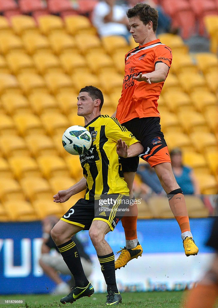 Corey Gameiro of the Phoenix and James Donachie of the Roar compete for the ball during the round 21 A-League match between the Brisbane Roar and the Wellington Phoenix at Suncorp Stadium on February 17, 2013 in Brisbane, Australia.