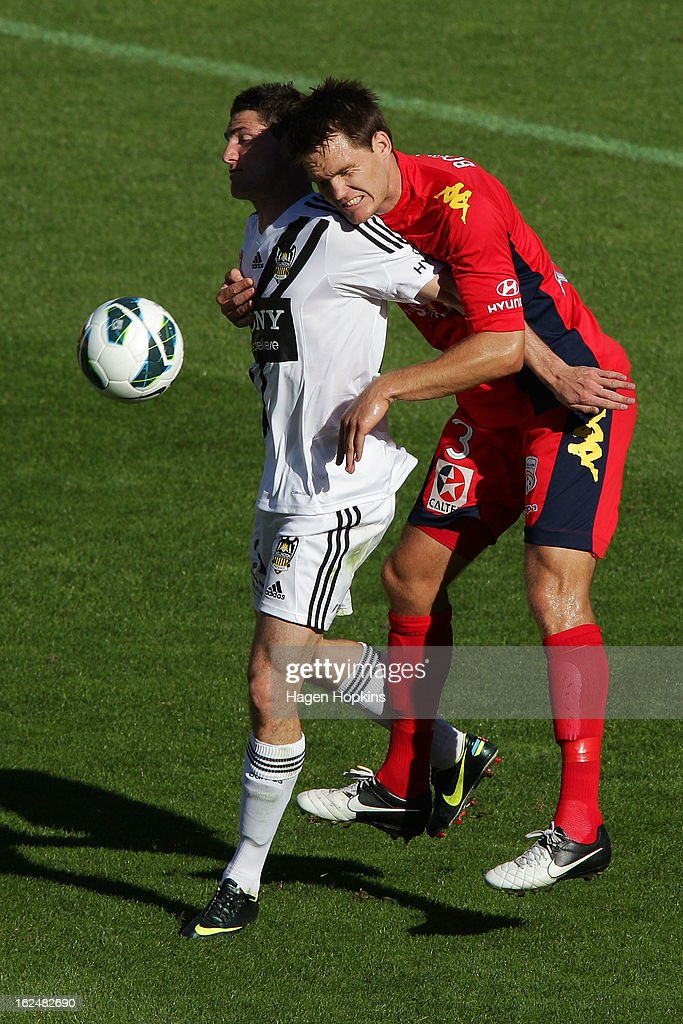 Corey Gameiro of the Phoenix and Nigel Boogaard of Adelaide compete for a header during the round 22 A-League match between the Wellington Phoenix and Adelaide United at Westpac Stadium on February 24, 2013 in Wellington, New Zealand.