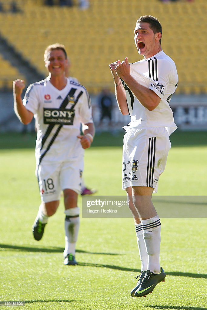 Corey Gameiro of the Phoenix celebrates his goal while Ben Sigmund looks on during the round 22 A-League match between the Wellington Phoenix and Adelaide United at Westpac Stadium on February 24, 2013 in Wellington, New Zealand.