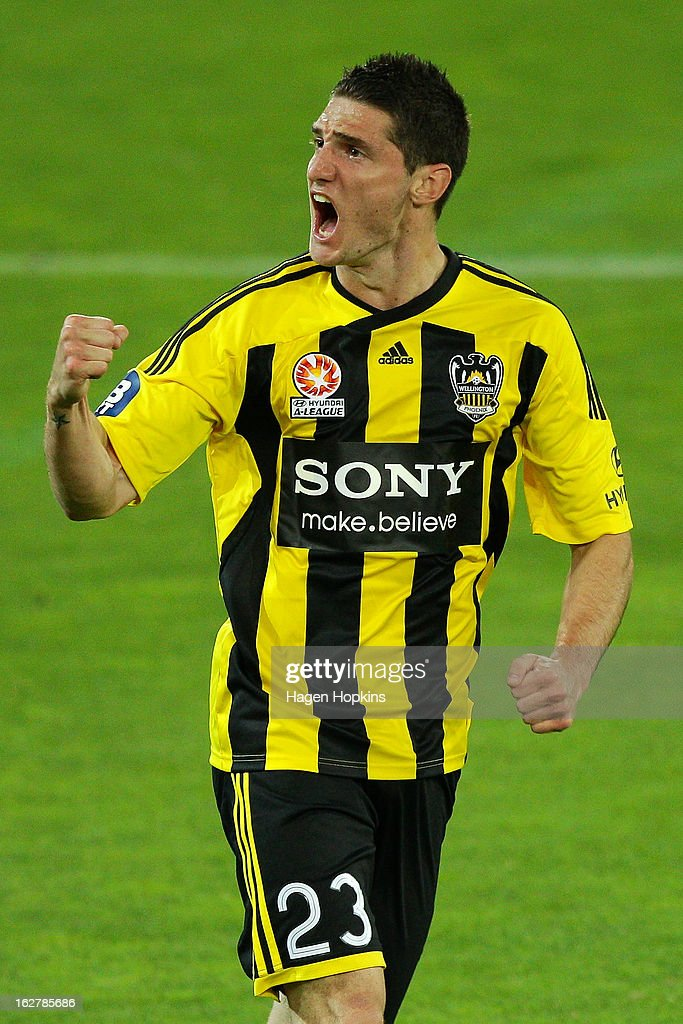 Corey Gameiro of the Phoenix celebrates the goal of Jeremy Brockie during the round 26 A-League match between the Wellington Phoenix and the Newcastle Jets at Westpac Stadium on February 27, 2013 in Wellington, New Zealand.