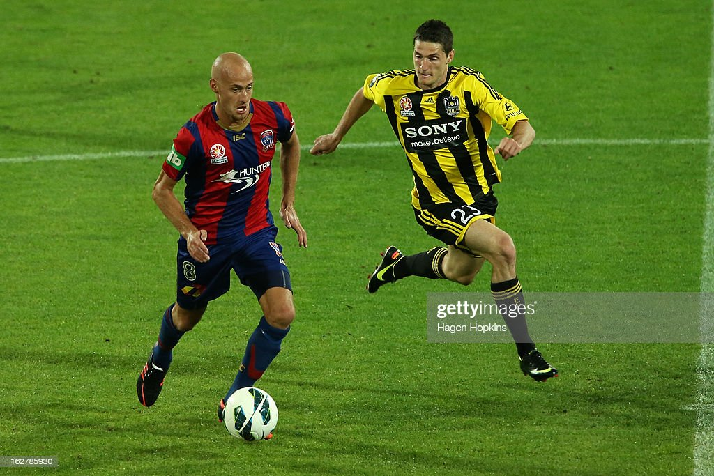 Corey Gameiro of the Phoenix defends against <a gi-track='captionPersonalityLinkClicked' href=/galleries/search?phrase=Ruben+Zadkovich&family=editorial&specificpeople=791211 ng-click='$event.stopPropagation()'>Ruben Zadkovich</a> of the Jets during the round 26 A-League match between the Wellington Phoenix and the Newcastle Jets at Westpac Stadium on February 27, 2013 in Wellington, New Zealand.