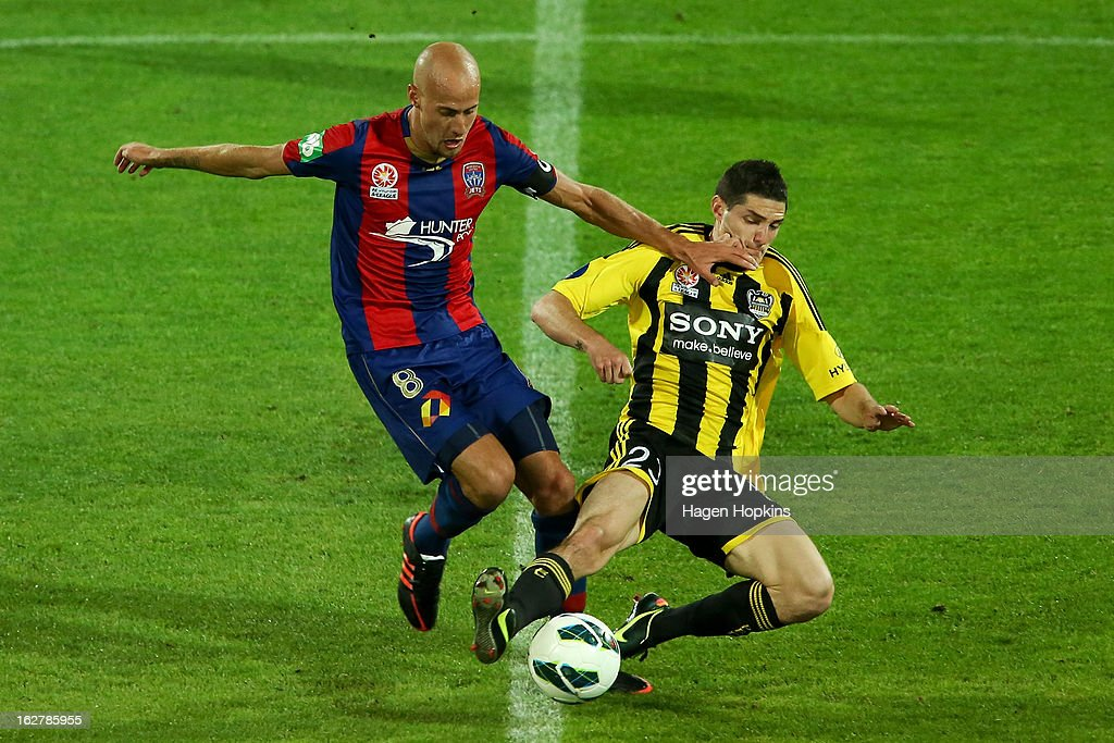 Corey Gameiro of the Phoenix tackles <a gi-track='captionPersonalityLinkClicked' href=/galleries/search?phrase=Ruben+Zadkovich&family=editorial&specificpeople=791211 ng-click='$event.stopPropagation()'>Ruben Zadkovich</a> of the Jets during the round 26 A-League match between the Wellington Phoenix and the Newcastle Jets at Westpac Stadium on February 27, 2013 in Wellington, New Zealand.