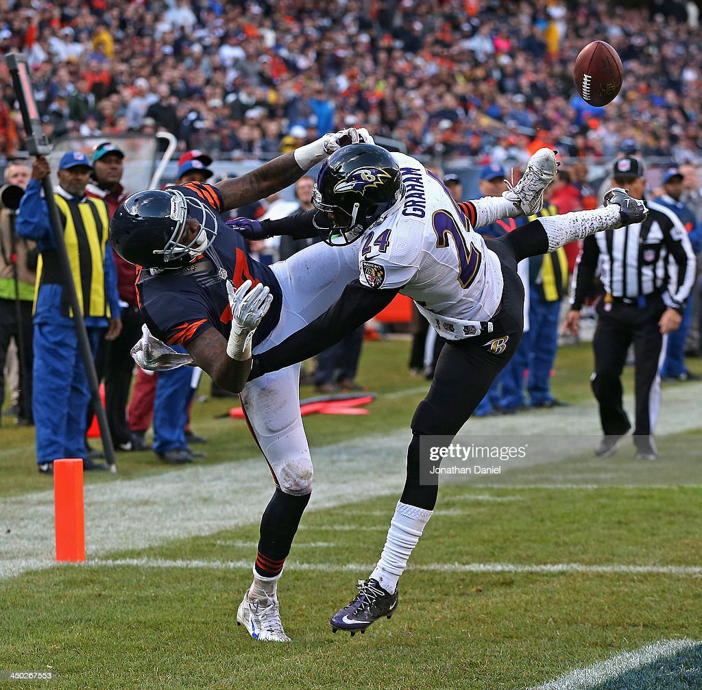 Corey Graham #24 of the Baltimore Ravens breaks up a pass in the end zone intended for Alshon Jeffery #17 of the Chicago Bears at Soldier Field on November 17, 2013 in Chicago, Illinois. The Bears defeated the Ravens 23-20 in overtime.