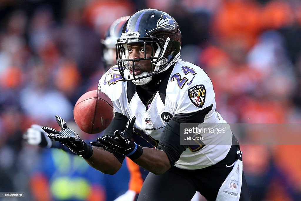 <a gi-track='captionPersonalityLinkClicked' href=/galleries/search?phrase=Corey+Graham&family=editorial&specificpeople=4294650 ng-click='$event.stopPropagation()'>Corey Graham</a> #24 of the Baltimore Ravens intercepts a pass by Peyton Manning #18 of the Denver Broncos which Graham returnd for a 39-yard touchdown in the first quarter during the AFC Divisional Playoff Game at Sports Authority Field at Mile High on January 12, 2013 in Denver, Colorado.
