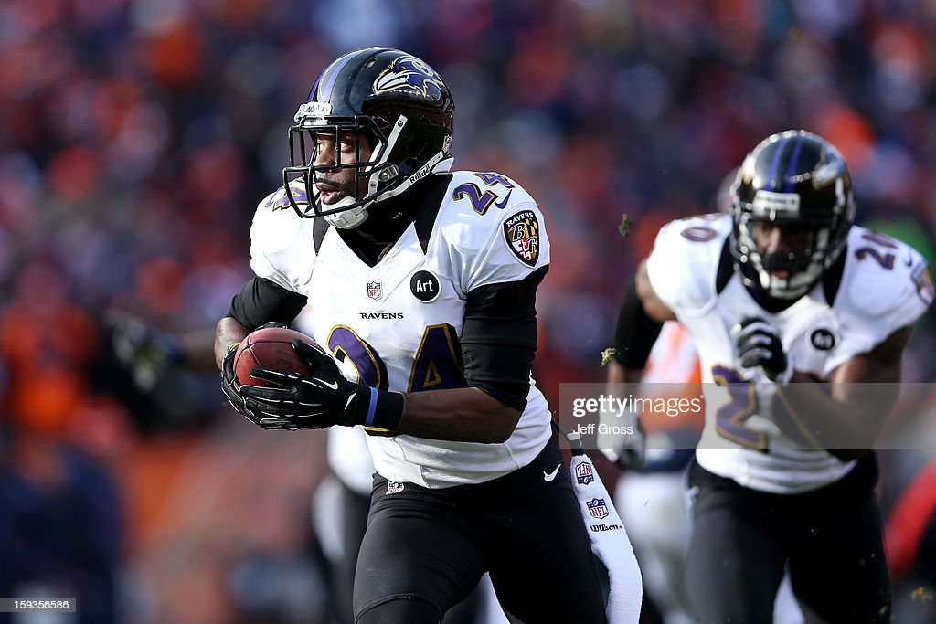 <a gi-track='captionPersonalityLinkClicked' href=/galleries/search?phrase=Corey+Graham&family=editorial&specificpeople=4294650 ng-click='$event.stopPropagation()'>Corey Graham</a> #24 of the Baltimore Ravens returns an interception 39-yards for a touchdown in the first quarter against the Denver Broncos during the AFC Divisional Playoff Game at Sports Authority Field at Mile High on January 12, 2013 in Denver, Colorado.