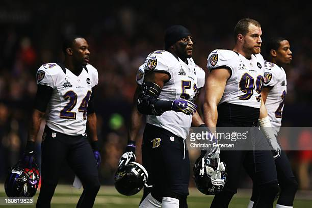 Corey Graham Ray Lewis and Paul Kruger of the Baltimore Ravens walk towards the sideline as play was suspended in the third quarter for 34 minutes...