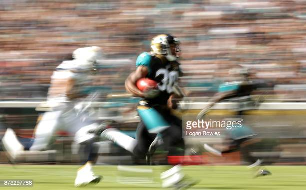Corey Grant of the Jacksonville Jaguars runs for a 56yard touchdown during the first half of their game against the Los Angeles Chargers at EverBank...