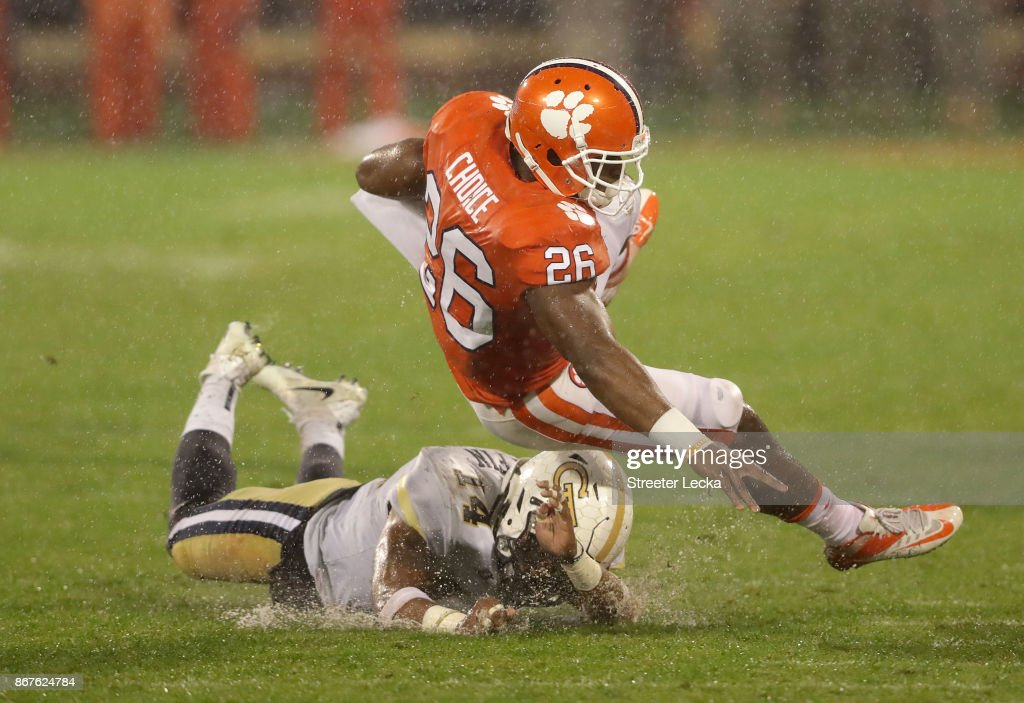 Corey Griffin #14 of the Georgia Tech Yellow Jackets tackles Adam Choice #26 of the Clemson Tigers during their game at Memorial Stadium on October 28, 2017 in Clemson, South Carolina.