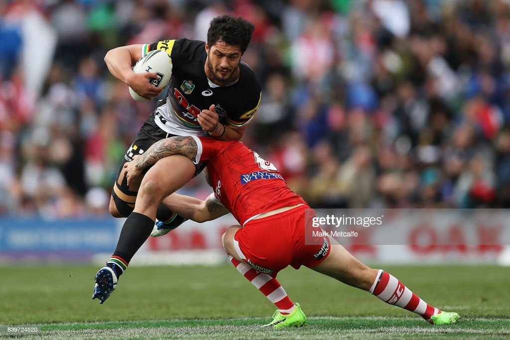 Corey Harawira Naera of the Panthers is tackled by Gareth Widdop of the Dragons during the round 25 NRL match between the Penrith Panthers and the St George Illawarra Dragons at Pepper Stadium on August 27, 2017 in Sydney, Australia.