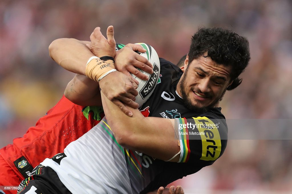 Corey Harawira Naera of the Panthers is tackled during the round 25 NRL match between the Penrith Panthers and the St George Illawarra Dragons at Pepper Stadium on August 27, 2017 in Sydney, Australia.