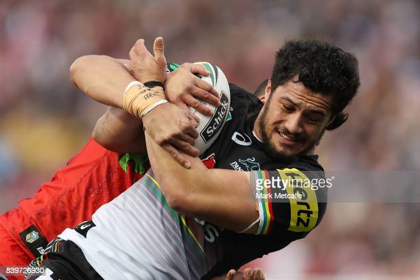 Corey Harawira Naera of the Panthers is tackled during the round 25 NRL match between the Penrith Panthers and the St George Illawarra Dragons at...