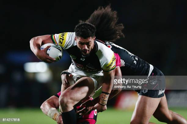 Corey HarawiraNaera of the Panthers is tackled by Bunty Afoa of the Warriors during the round 19 NRL match between the New Zealand Warriors and the...