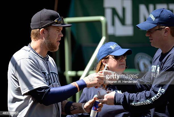 Corey Hart of the Seattle Mariners signs an autograph for a fan prior to the start of his game against the Oakland Athletics at Oco Coliseum on April...