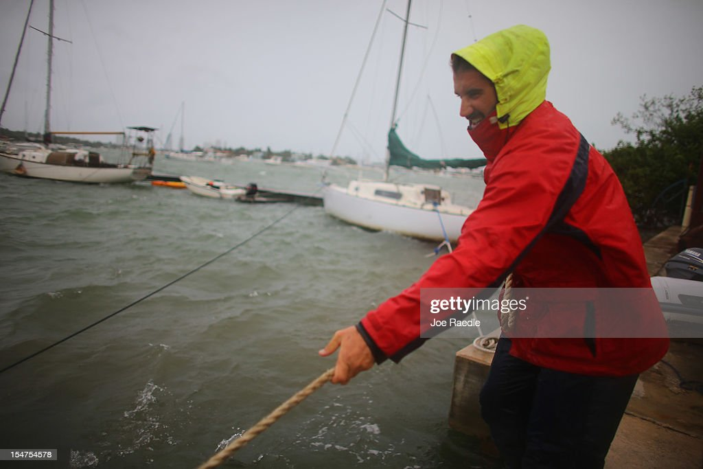 Corey Hutterli works on securing his sailboat with rope as the outer bands of Hurricane Sandy are felt on October 25, 2012 in Miami Beach, Florida. After passing over Jamaica and eastern Cuba Hurricane Sandy is expected to hit eastern Cuba and head into the Bahamas Thursday and Friday, there is a tropical storm warning in place for coastal Miami-Dade, Broward, and Palm Beach Counties and the Atlantic waters off southeast Florida.