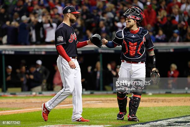 Corey Kluber and Roberto Perez of the Cleveland Indians react after the second inning against the Chicago Cubs in Game One of the 2016 World Series...