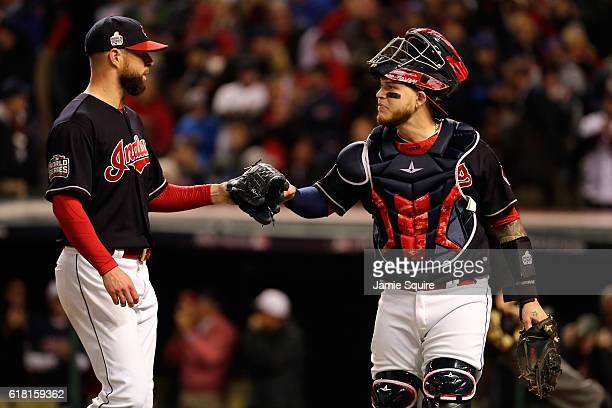 Corey Kluber and Roberto Perez of the Cleveland Indians react against the Chicago Cubs in Game One of the 2016 World Series at Progressive Field on...