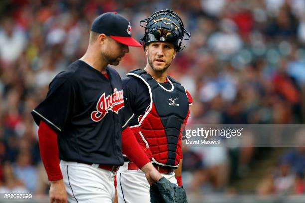 Corey Kluber and Yan Gomes of the Cleveland Indians meet between the mound and home plate against the New York Yankees in the first inning at...