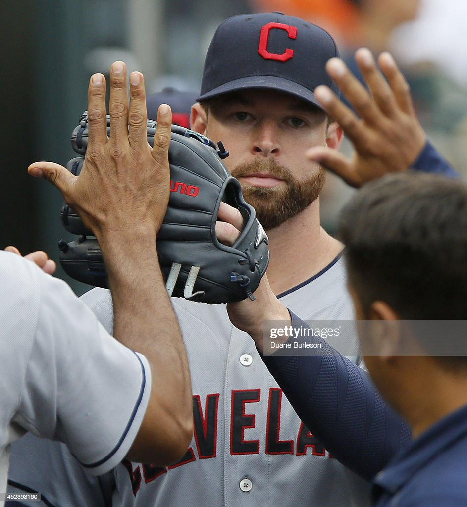 <a gi-track='captionPersonalityLinkClicked' href=/galleries/search?phrase=Corey+Kluber&family=editorial&specificpeople=7513243 ng-click='$event.stopPropagation()'>Corey Kluber</a> #28 of the Cleveland Indians is congratulated after being relieved during the ninth inning of a 6-2 win over the Detroit Tigers in game one of a doubleheader at Comerica Park on July 19, 2014 in Detroit, Michigan.