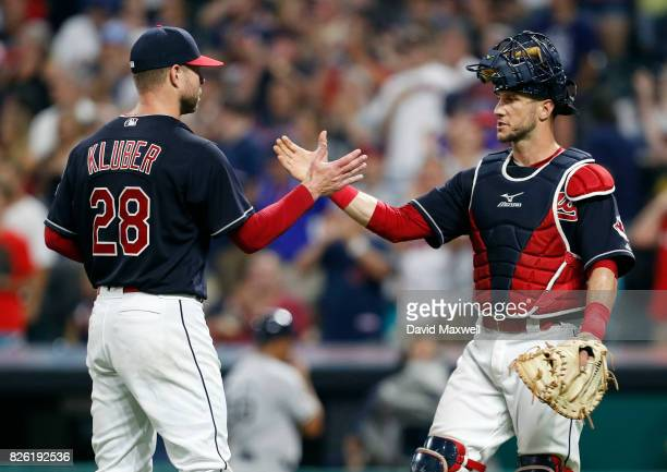 Corey Kluber of the Cleveland Indians pitches is congratulated by Yan Gomes after pitching a complete game against the New York Yankees at...