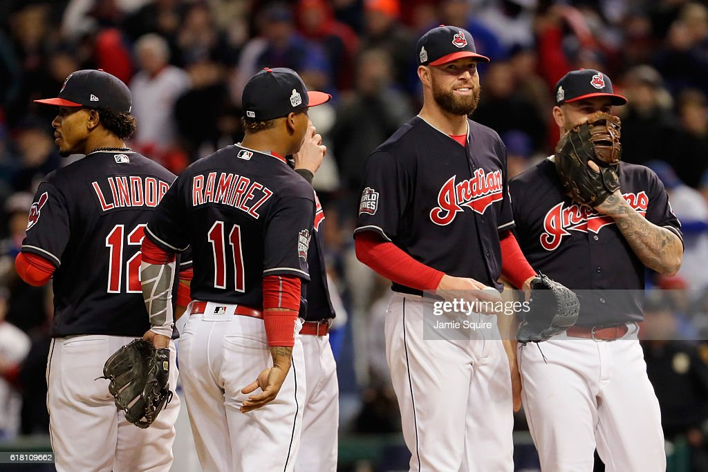 Corey Kluber #28 of the Cleveland Indians (2nd-R) reacts on the pitcher's mound prior to being relieved during the seventh inning against the Chicago Cubs in Game One of the 2016 World Series at Progressive Field on October 25, 2016 in Cleveland, Ohio.