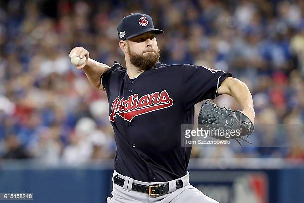 Corey Kluber of the Cleveland Indians throws a pitch in the second inning against the Toronto Blue Jays during game four of the American League...