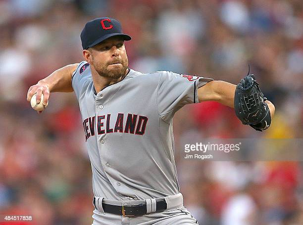 Corey Kluber of the Cleveland Indians throws against the Boston Red Sox catches in the first inning on August 19 2015 in Boston Massachusetts