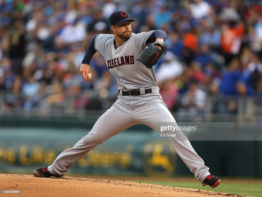 Corey Kluber #28 of the Cleveland Indians throws in the first inning against the Kansas City Royals at Kauffman Stadium on June 10, 2014 in Kansas City, Missouri.